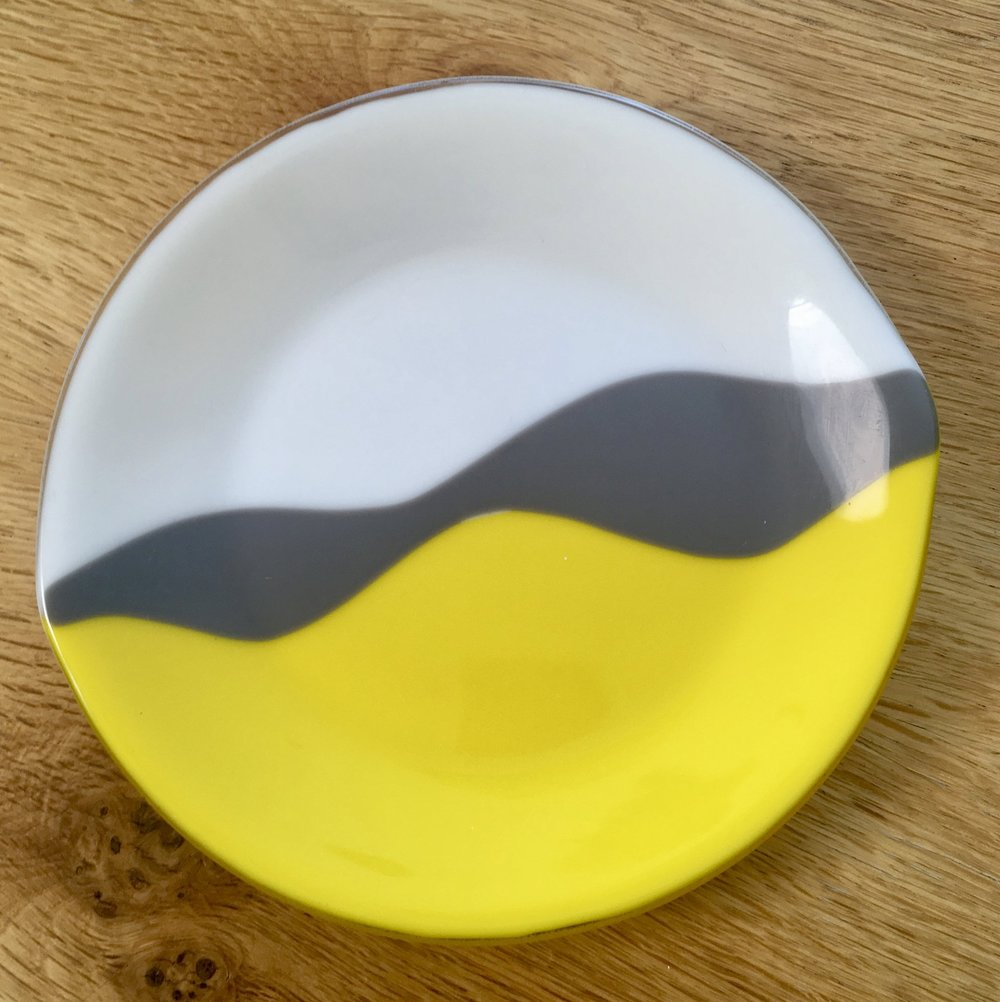 I liked the idea of this lovely yellow with the grey and white and decided to make this 20 inch plate to use bring them together.  It's fused at a high temperature and has a smooth finish which looks looks quite cool I think.