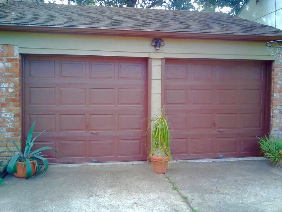 installed garage doors and painting.jpg