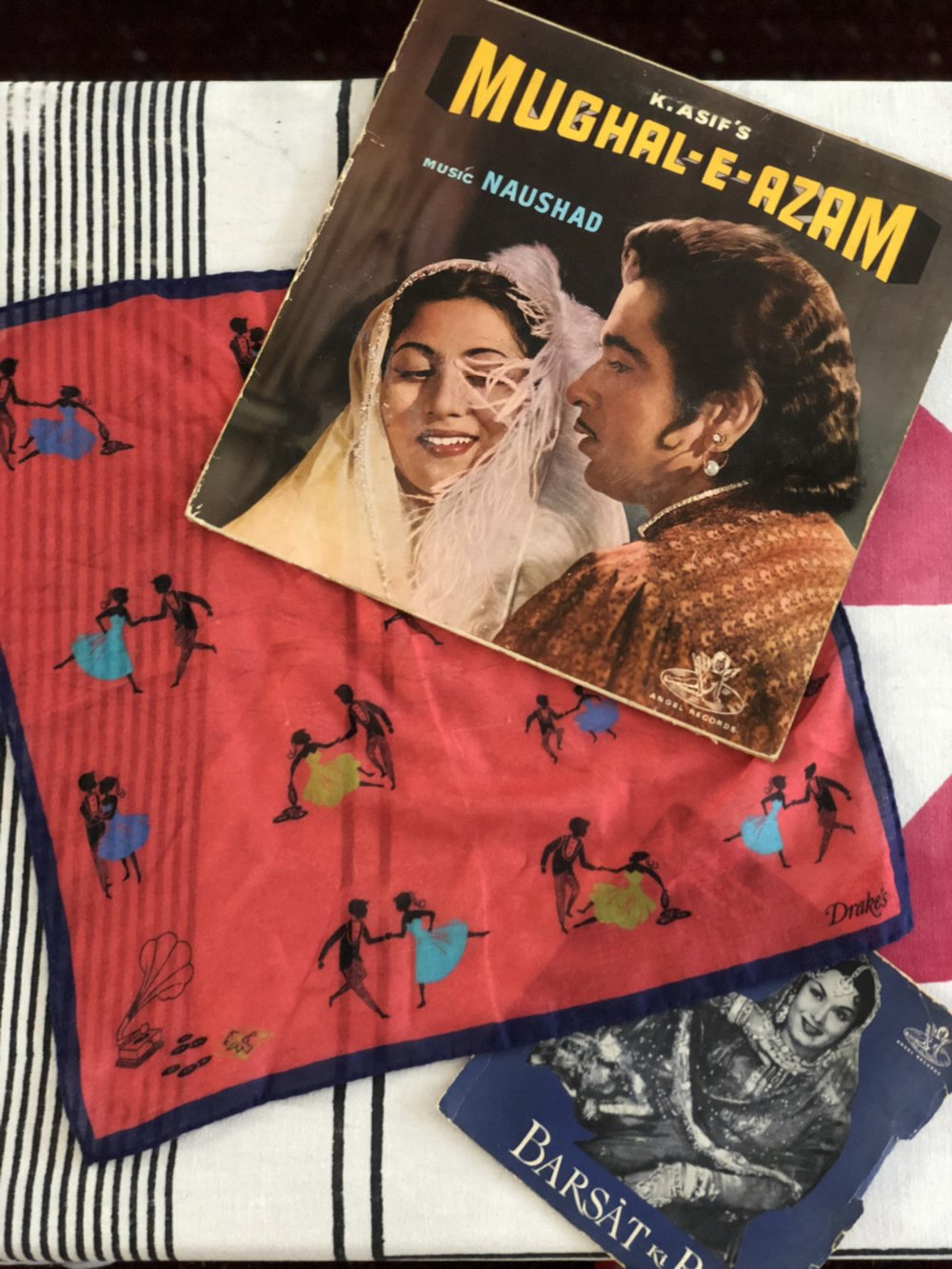 A pocket square by Drake's with some vintage Bollywood records.