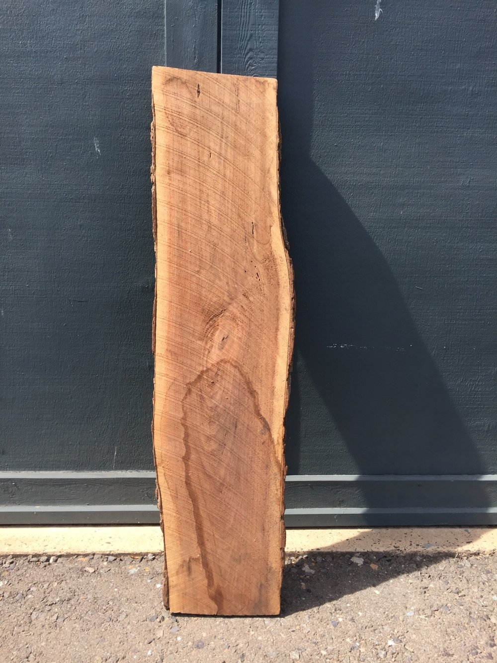 Get a slab of live edge lumber - walnut in this case - with nice character.