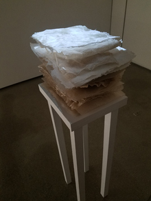 "Adriana Barrios, ""Handle With Care"" is made from handmade abaca sand paper with video projection"