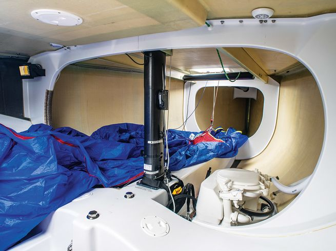 The IC37's interior is all business: cork flooring, no furniture and a no-privacy head.   Photo by Walter Cooper