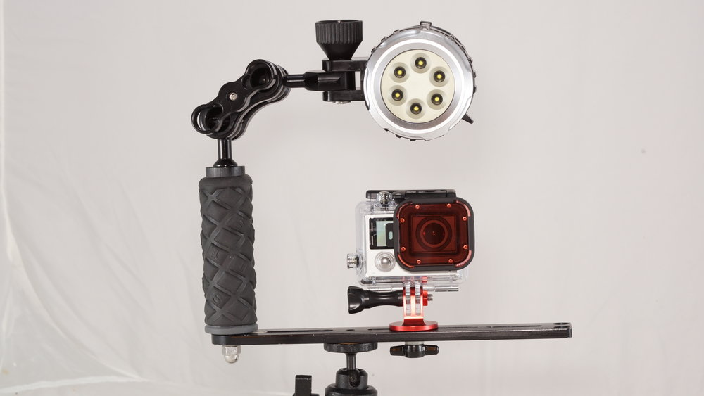 Light with Mount Continuous lighting. We can mount any camera on the light tray. The light brings out more colors and lights up the shadows and crevasses.    -