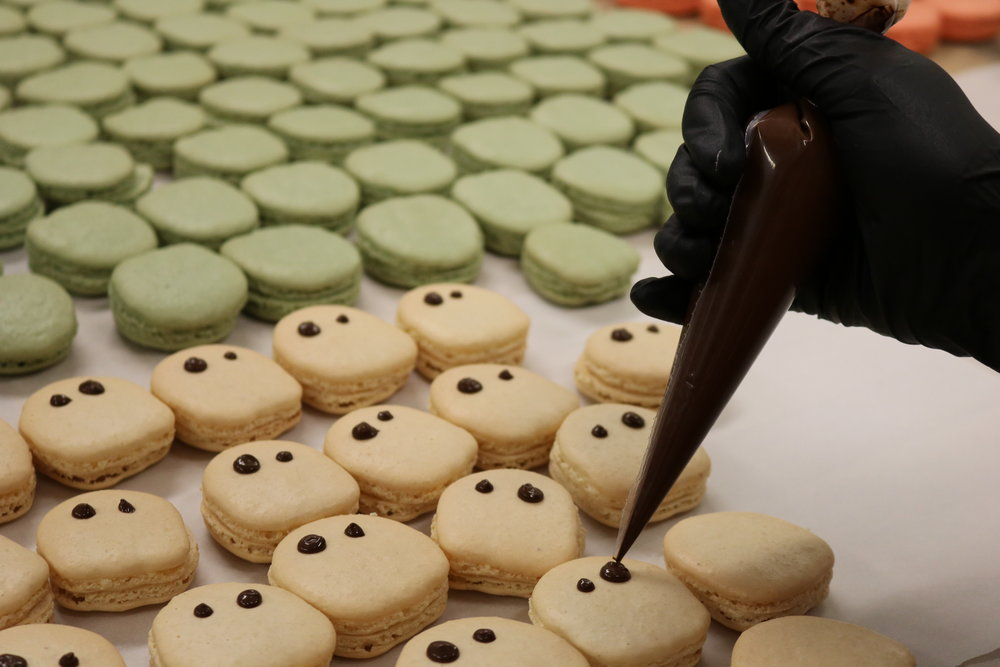 Decorating the Blooo Berry ghosts - white chocolate blueberry ganache - 20mg THC each