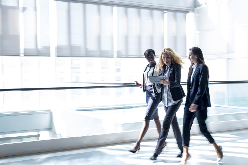 Business-women-walking-in-a-hall-659285520_1257x837.jpeg