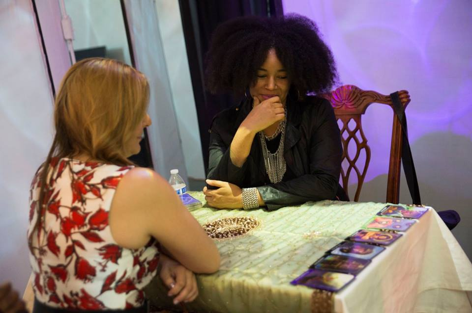 Rhonda giving a tarot card reading to a guest at Chicago Art Department's Crystal Ball annual fundraiser.