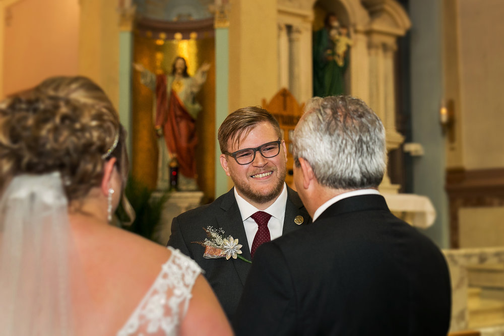bride father gives daughter away