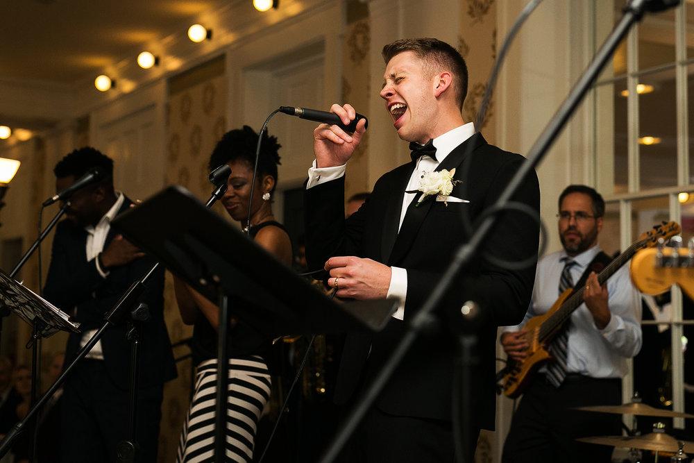 groom serenades bride
