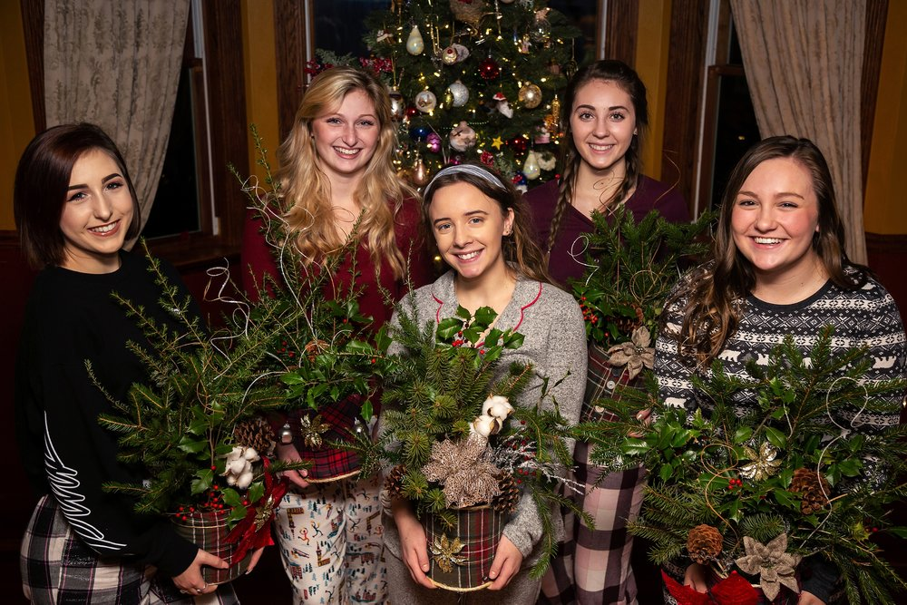 2019 VIP Representatives create christmas evergreen centerpieces to donate to a local nursing home (Saint Andrew's village, Indiana PA). Jessica Miladinovich, Lauren Wilner, Marissa Tunstall, Maggie Arone, Blake Tonkin.