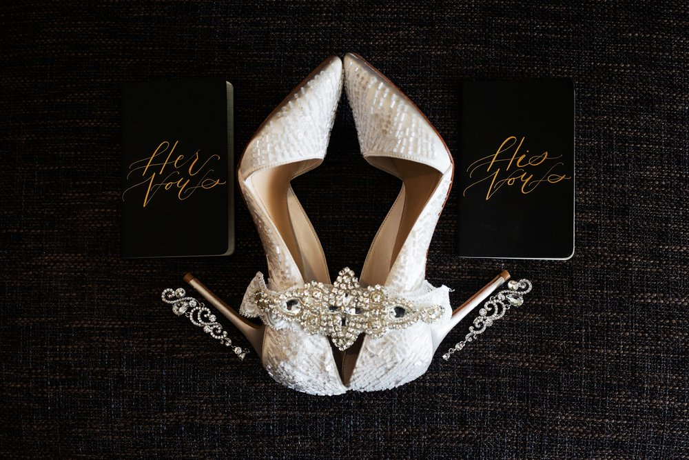 wedding shoes and vow books