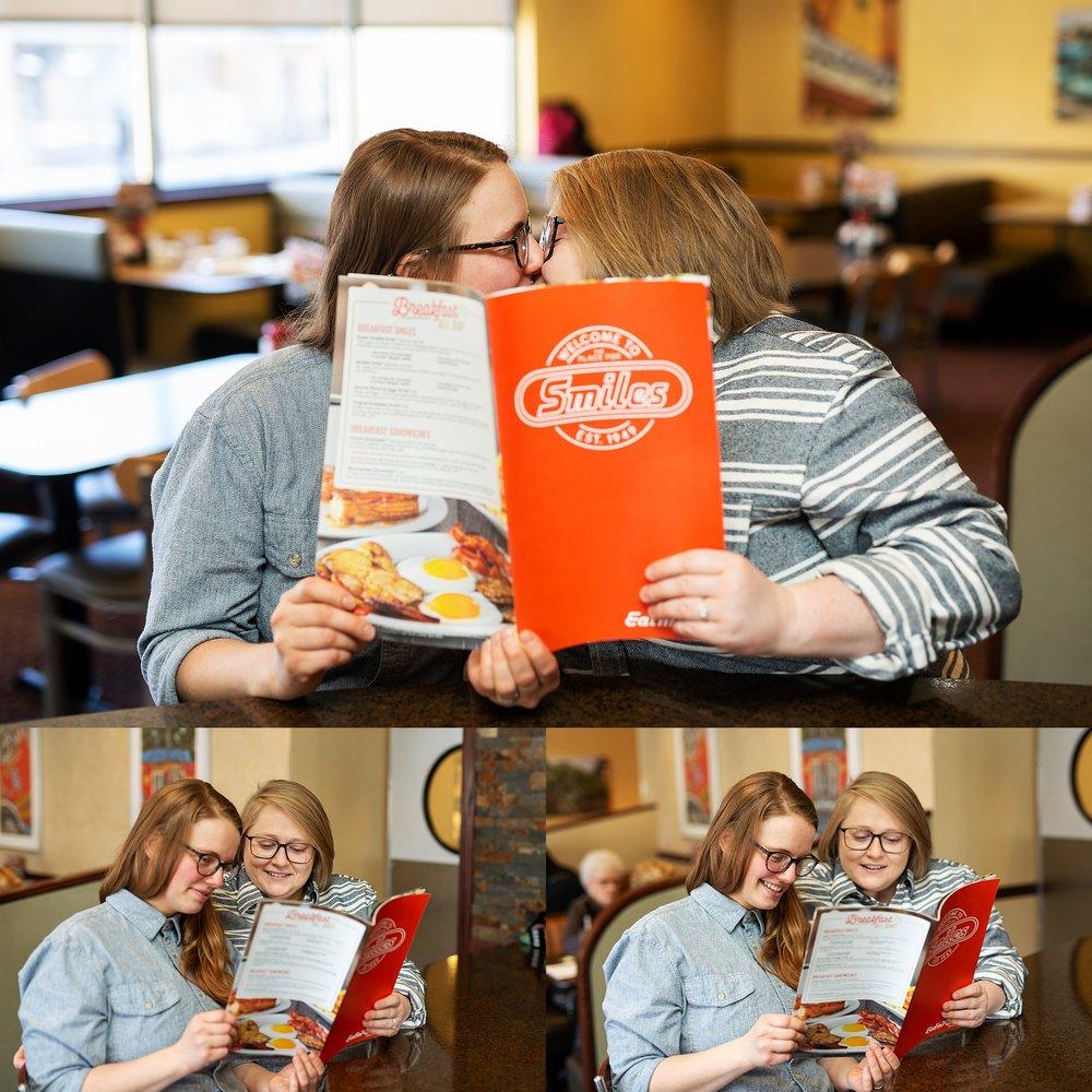 couple kisses behind menu