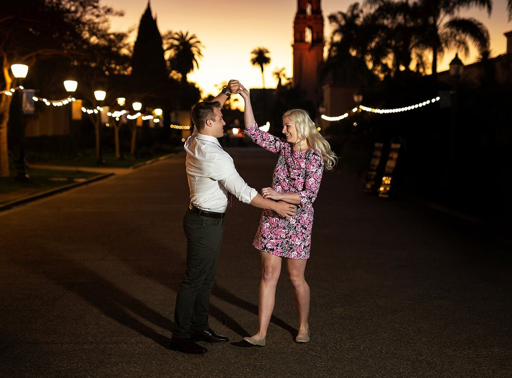 Cora and Zach share a dance during their engagement session in Balboa Park, San Diego California