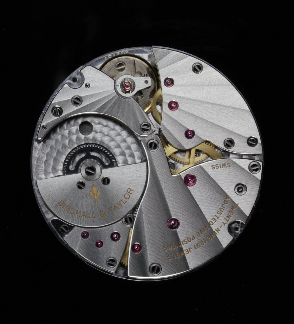 Micro-rotor automatic Movement - Ticking away within the Reference 1 is a 29-jewel, ultra-thin, micro-rotor automatic movement. Its finishing includes hand-polished bevels and radial côtes de Genève, all visible through the back of the case. The movement is a formidable example of fine, traditional watchmaking. This movement is produced in partnership with renowned manufacture Vaucher based in Fleurier, Switzerland.