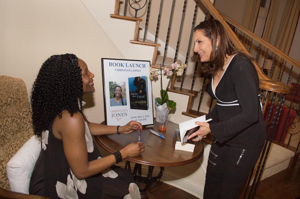 Signing a book for Master Lisethe Salcido