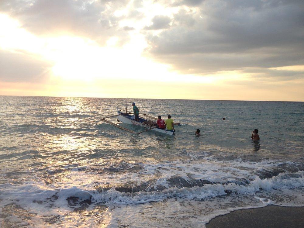 San Narciso beach. Watching the fishermen at dusk.