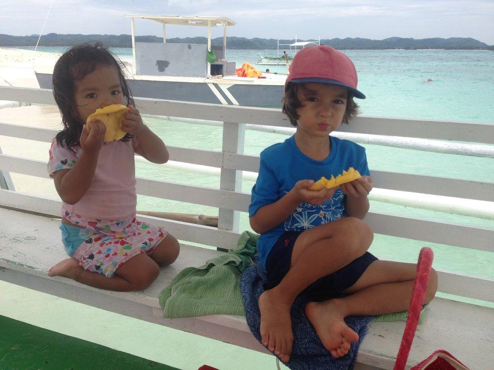 Enjoying mangoes at Naked Island