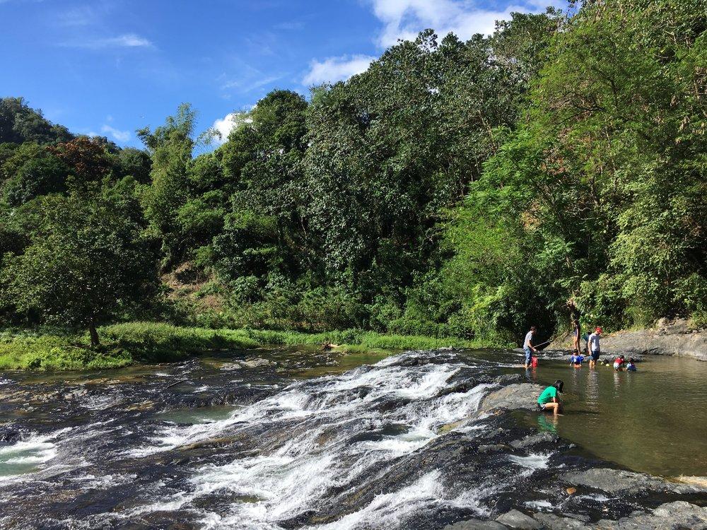 Playing at Bunsuran falls