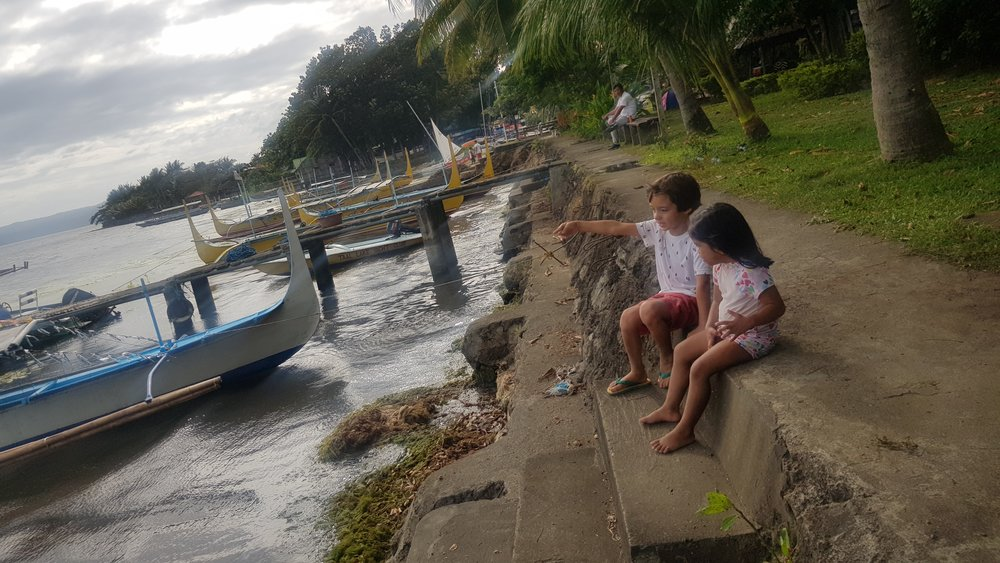 Kids enjoying the view from Taal Lake Yacht Club