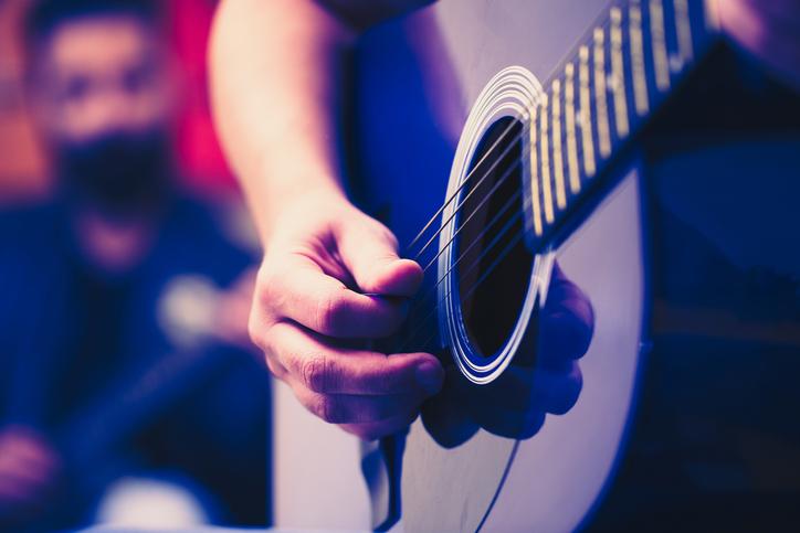 guitarist strumming