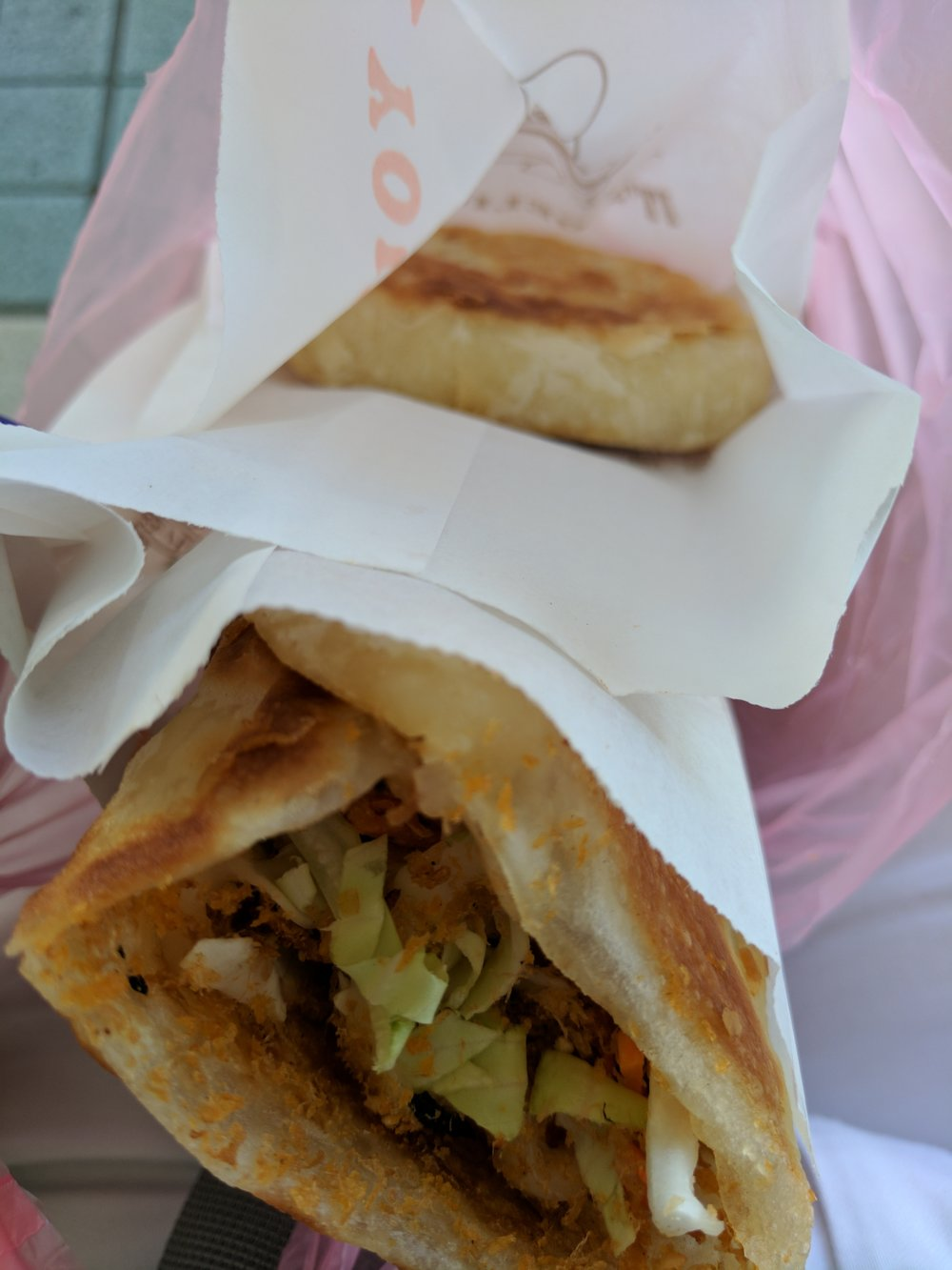cheap, delicious street food. this crepe thing was soooo good. shao bing with shredded turnips inside wasn't bad.