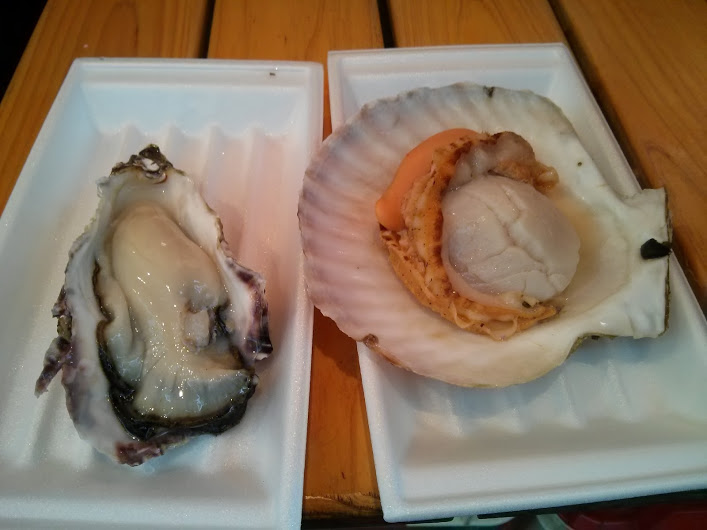 freakin' delicious street food: fresh oyster and steamed scallop.