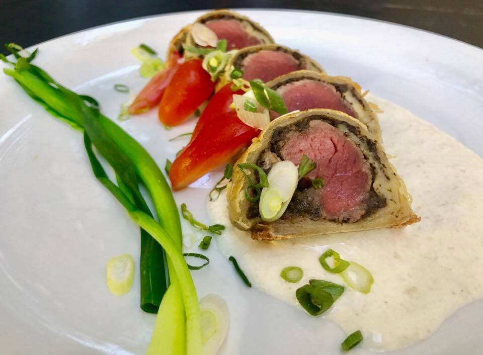 4th Course - Beef Wellington Bites - Traditional beef wellington served in bite size portions made with local beef tenderloin and a rich mushroom duxelle baked in puff pastry and served with a horseradish cream sauce.