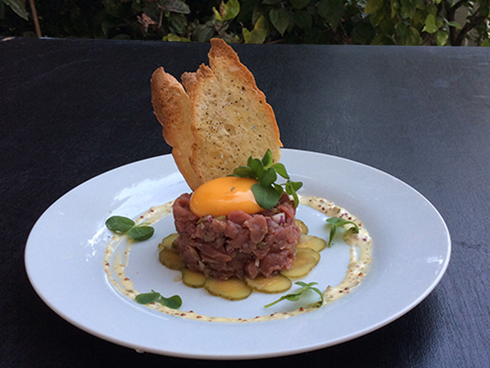 2nd Course - Steak Tartare - Diced raw filet mignon with shallots, capers, gherkins, green onions, and egg yolk, served with crispy crostini and a caper mustard aioli