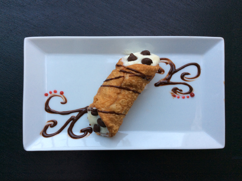 5th Course - Sicilian Style Cannoli - Housemade puff pastry shell with ricotta-mascarpone-chocolate chip filling, topped with a drizzle of chocolate bourbon sauce