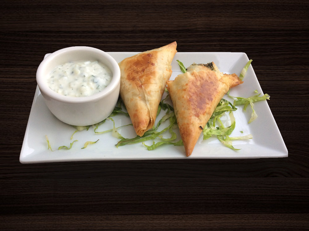 1st Course - Belizean Spanakopita - Crispy Phyllo dough filled with a combination of feta, ricotta, and goat cheeses, with fresh callaloo, baked, and served with tzatziki dipping sauce