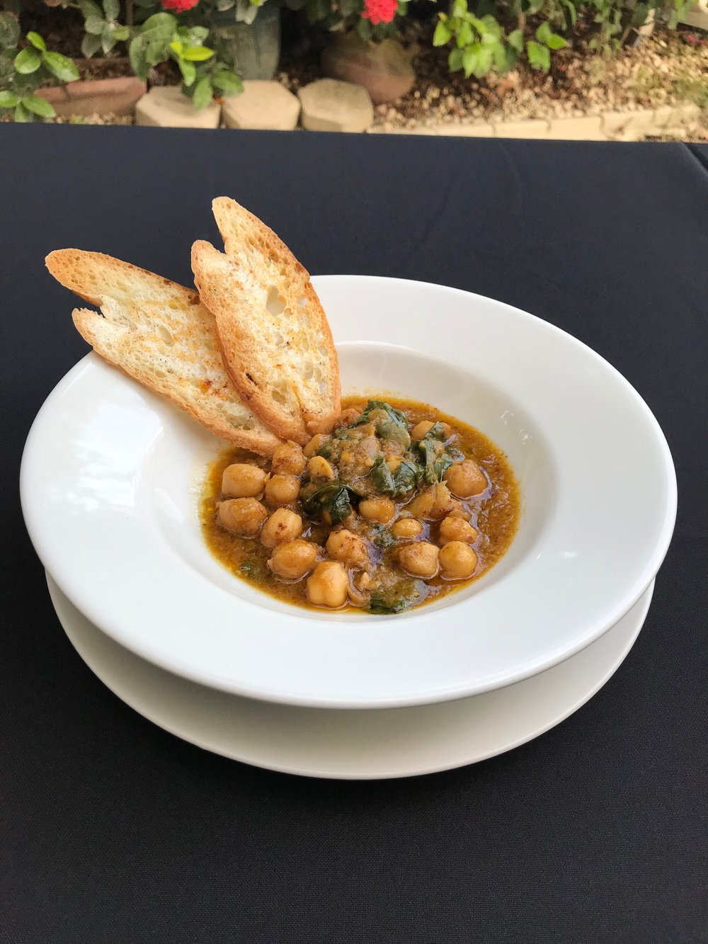 Chickpea & Spinach Stew  - Spanish style stew, with chickpeas and spinach, garlic, saffron, cumin, paprika, and sherry. Served with crostini