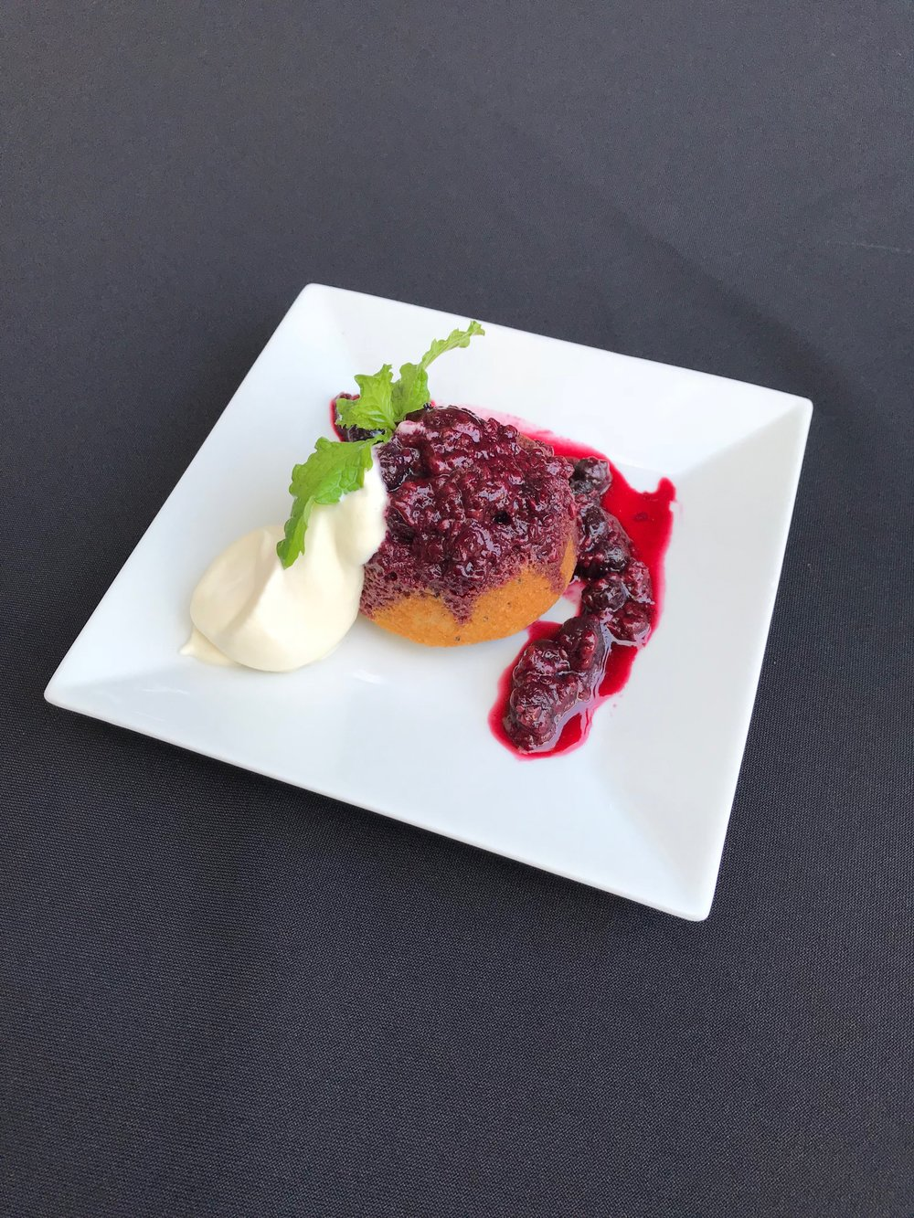 Lemon and Poppy Seed Cake  - Housemade cake topped with poached mixed berries and Chantilly cream