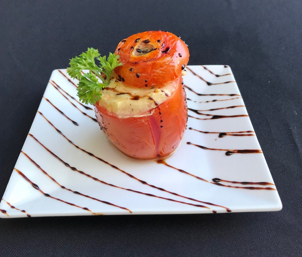 Stuffed Tomatoes - Baked plum tomatoes Stuffed with potato, parmesan, provolone, green onions, and a drizzle of balsamic reduction