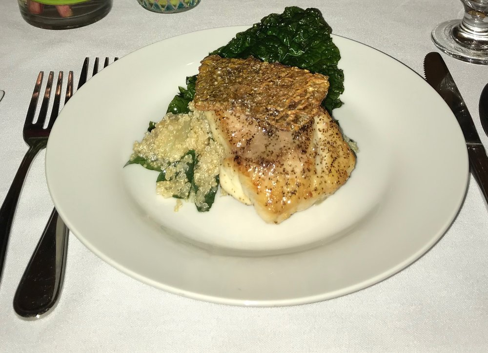 Pan Seared Snapper  - Pan seared snapper, served with kale, quinoa, grapefruit, tangerine segments, toasted almonds, and citrus vinaigrette