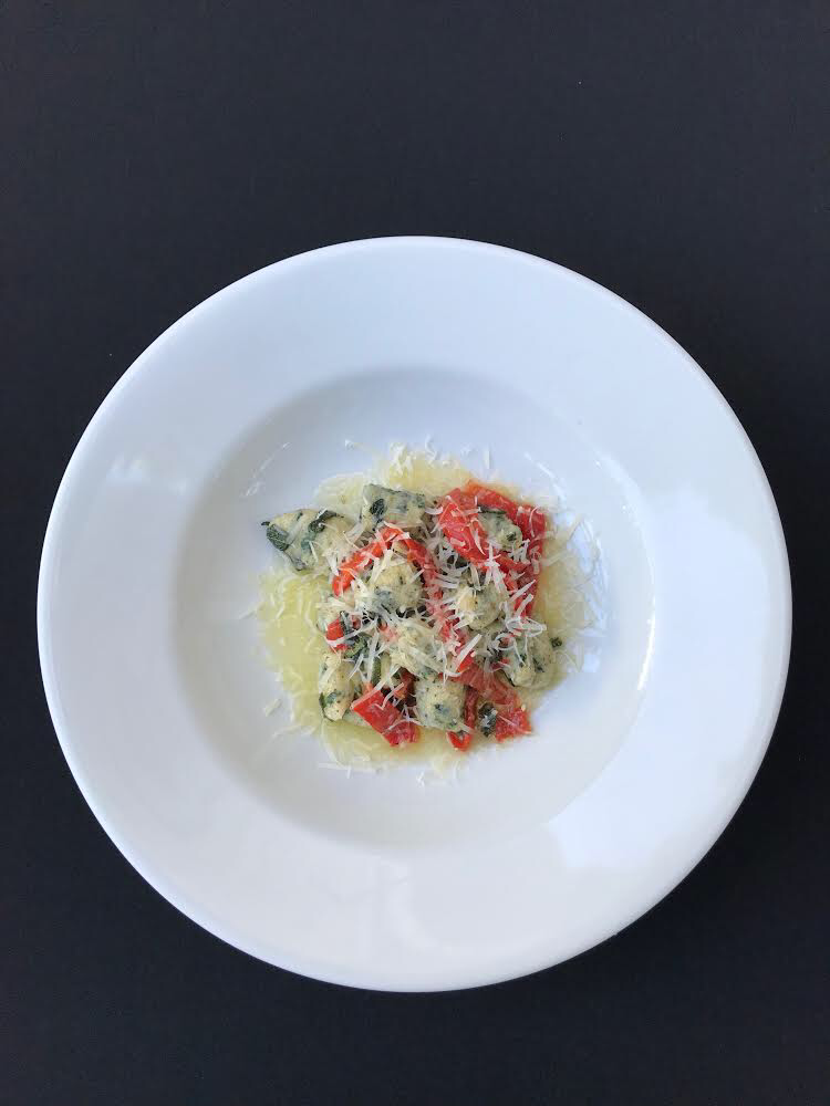 - Spinach Gnocchi Housemade gnocchi with spinach, ricotta, breadcrumbs, and fresh parmesan cheese, in a sage butter sauce and fire roasted red bell peppers