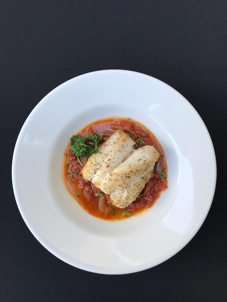 - Snapper in Tomato Confit Pan seared snapper over confit of tomato made with plum tomatoes, garlic, onions, parsley, white wine, and fish stock