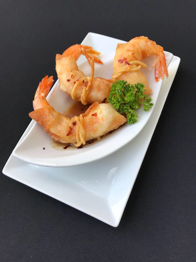 - Fire Cracker Shrimp Deep fried jumbo shrimp in wanton wrap, served with a house made tamarind & ginger sauce