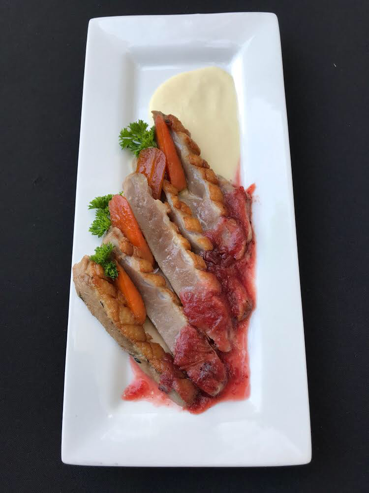 - Crispy Duck Breast Crispy duck breast with onion-apple veloute and apple cranberry gastrique