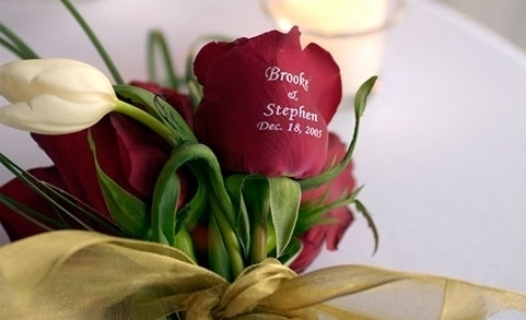 WEDDING FLOWERS - rose petals, bridal bouquets, groomsman boutonnieres, reception center pieces, altar displays, favors