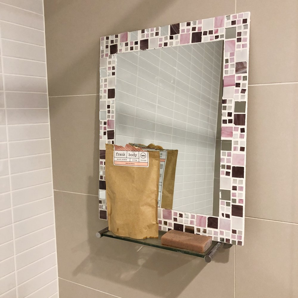 mirror on bathroom shelf
