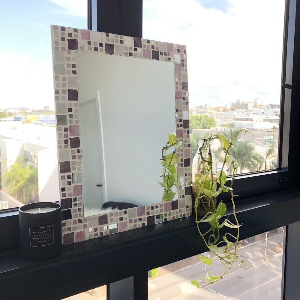 mirror on window ledge