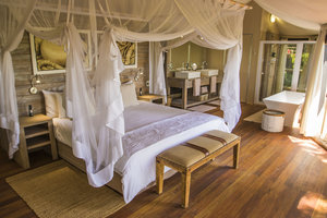 4.Nambwa+Tented+Suite+Bedroom.jpg
