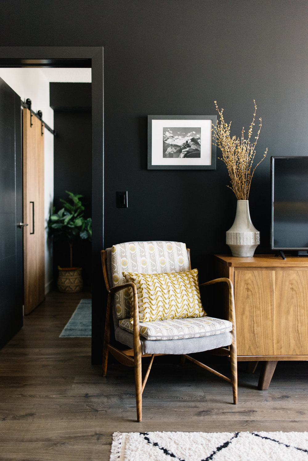 eclectic living room with black wall