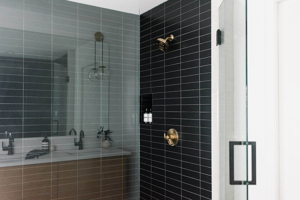 bathroom with black subway tile