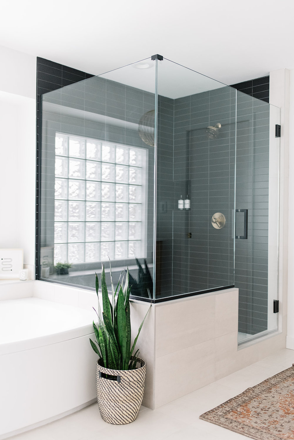 shower with black subway tile