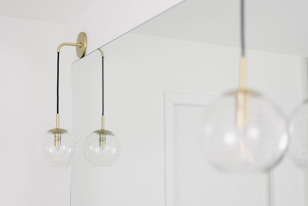 hanging pendant over bathroom mirror