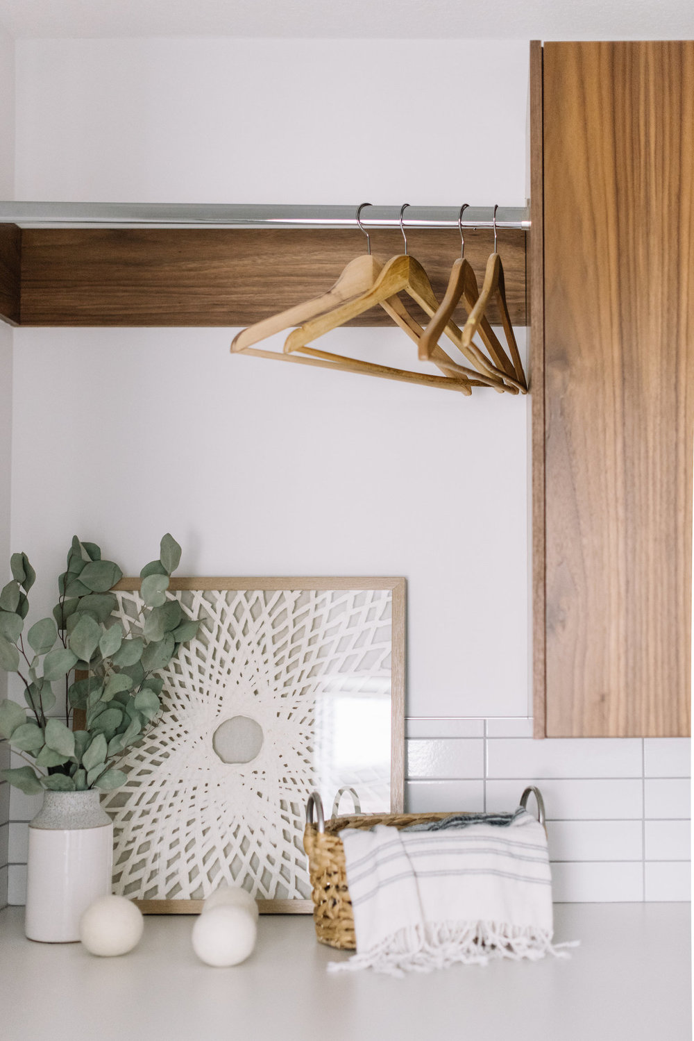 modern walnut cabinetry in laundry room