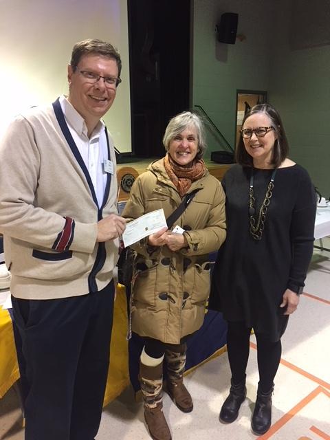Sheila Feore picking up cheque on behalf of Helen Matheson.