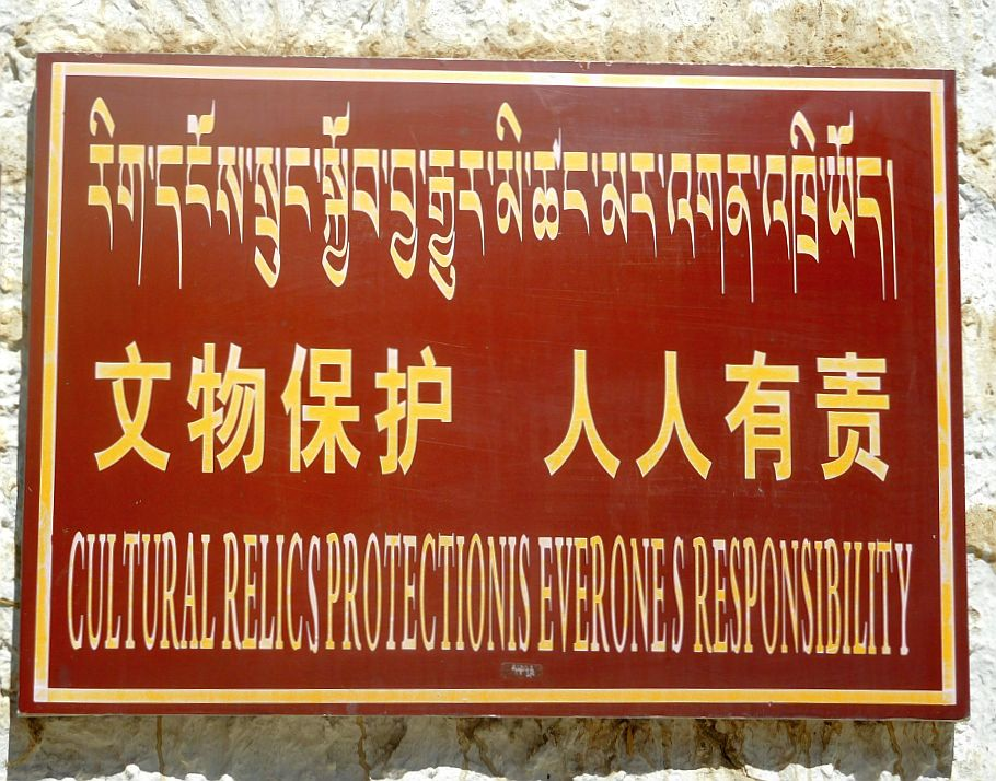 """Cultural relics protections, everyone's responsibility"" reads an ironic sign at Tashi Luhnpo monastery in Shigatse, Tibet. #culturalrevolution"
