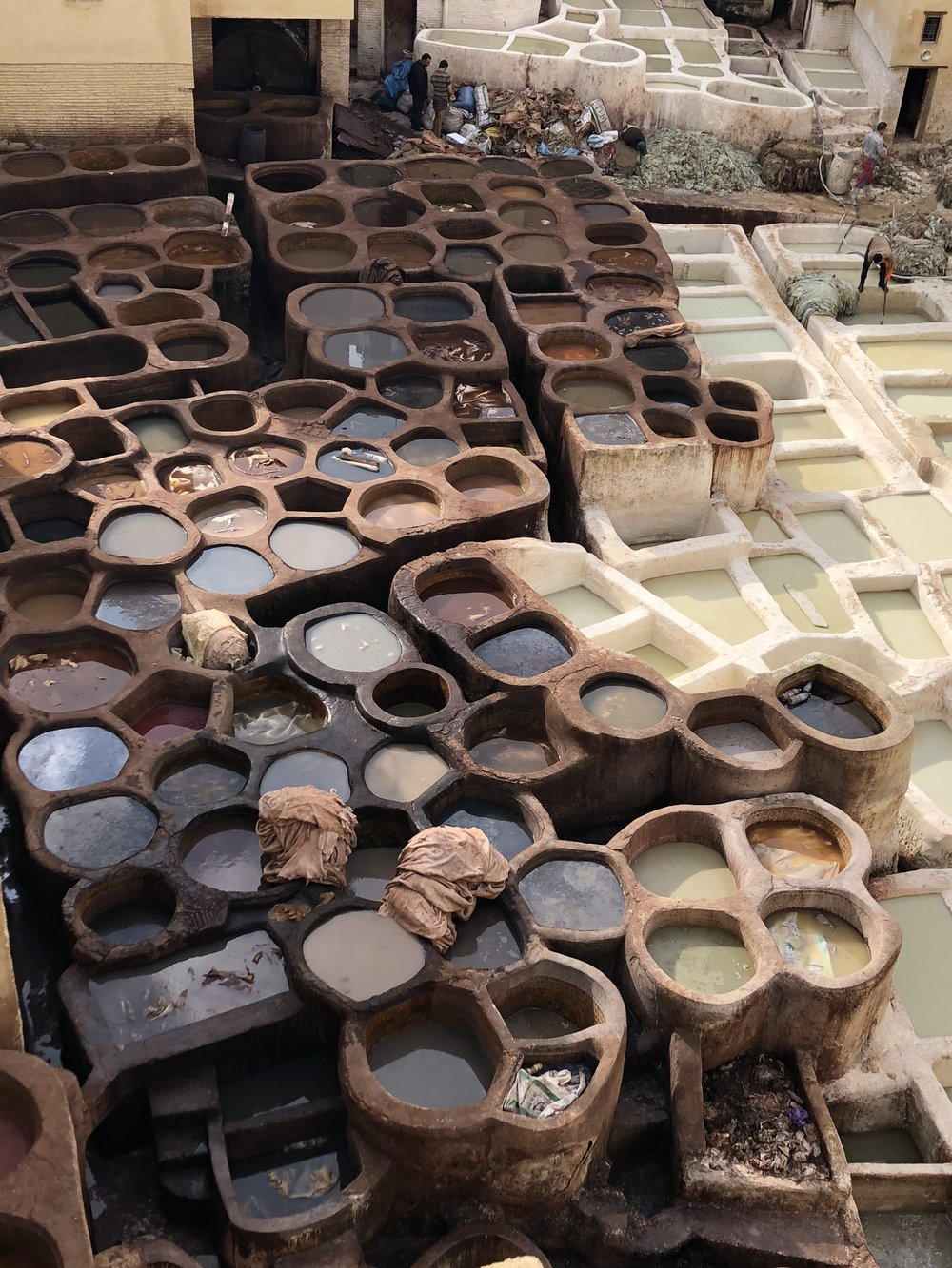 Acrid-smelling dye vats of the leather tanneries.
