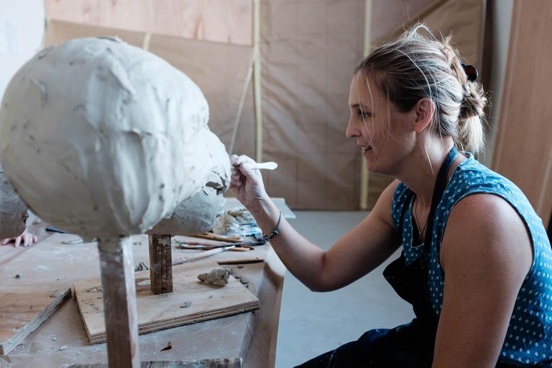 Janni sculpting some heads